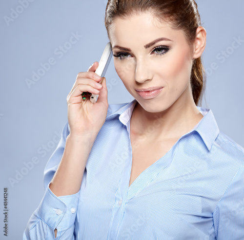 young woman speaking on phone in studio