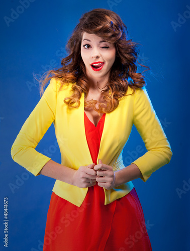 Colorful fresh portrait of a beautiful playful young woman