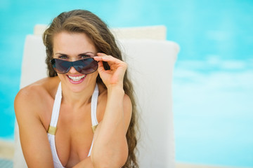 Portrait of happy young woman in swimsuit relaxing