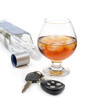 glass of alcohol and car keys