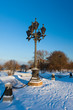 Antique frosty lamppost and beautiful snow