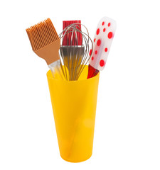 kitchen utensil in a yellow cup on a white background