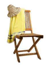 teak deck chair with sun hat and towel, isolated