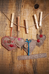 Decoration on Wooden background with fabric Hearts and words Val