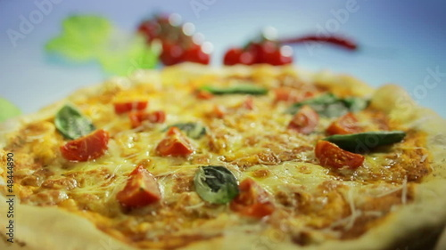 Pizza with basil and tomato