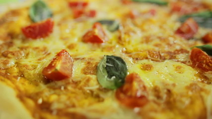 Vegetarian Pizza with basil and tomato close up