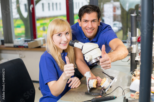 Dental technicians showing thumbs up