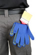 brush and gloves in back pocket close-up