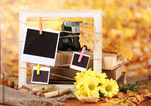 Autumnal composition with flowers, photo cards, wooden frame
