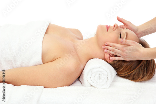 Portrait of beautiful woman taking head massage, isolated