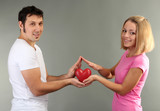 Loving couple on grey background