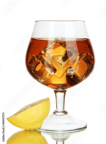 Glass of brandy with ice and lemon isolated on white