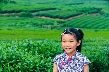 In the tea garden in traditional Chinese dress girl