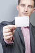 Businessman holding blank card