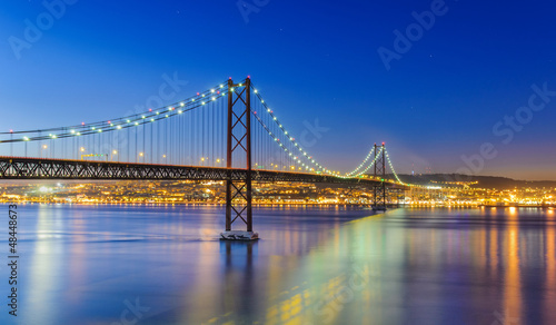 Zdjęcia na płótnie, fototapety, obrazy : Night view of Lisbon and of the 25 de Abril Bridge, Portugal