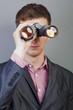 Businessmen looking through binocular