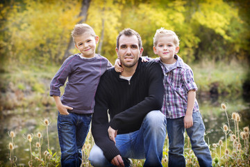 Outdoor portrait of a father and his two sons