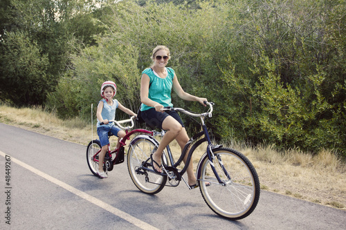 Family Enjoying a Bike Ride - 48449267