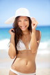Woman on beach smiling happy
