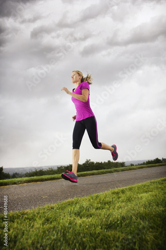 Female Runner working out on a rainy day