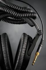 Modern headphones over black background
