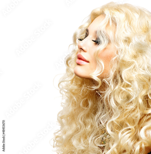 Beauty Girl With Healthy Long Curly Hair. Blonde Woman