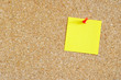 Cork board with yellow post-it
