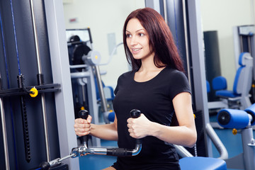 Slim woman training in a gym