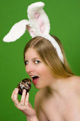 Young woman eating Easter egg