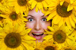 Portrait of a young woman with sunflowers
