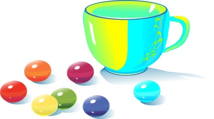 Teacup and multicolored candy