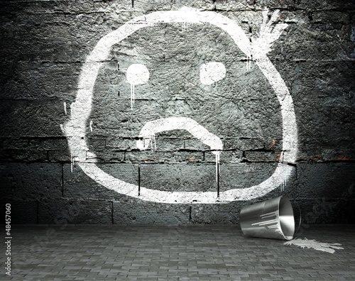 Graffiti wall with sad face, street background