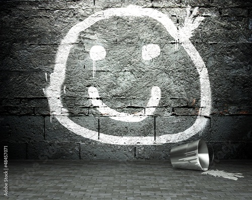 Graffiti wall with smile face, street background