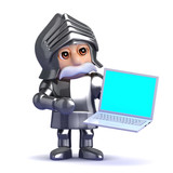 Knight holds a laptop