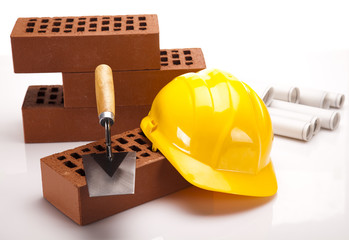 Building house, trowel and bricks