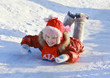 Girl sliding down a frozen hill