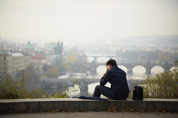 Sad man in autumn park, Prague