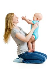 loving mother holding baby boy isolated on white