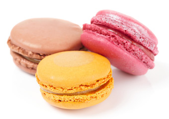 Three colorful macarons isolated on white