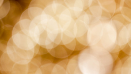 Festive background with defocused golden lights