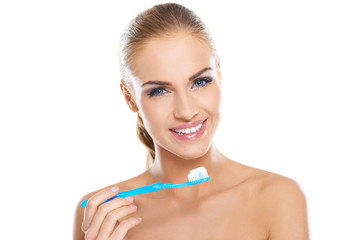 Beautiful woman with a toothbrush and paste
