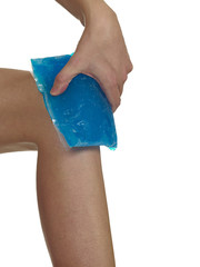 Cool gel pack on a swollen hurting knee.