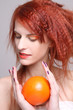 redhaired girl with orange in her hands
