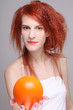 portrait of redhaired girl with orange