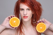 redhaired girl with orange half