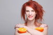 smiling redhaired woman with orange half