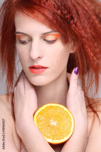 portrait of redhaired woman with orange half