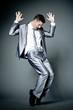 Happy businessman in gray suit.