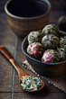White tea balls and dried lemon grass in a dish