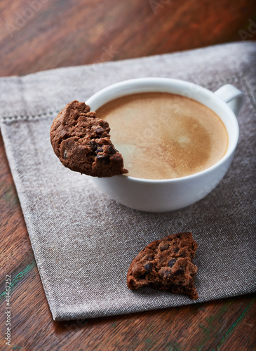 Cup of cafe crema with chocolate cookie